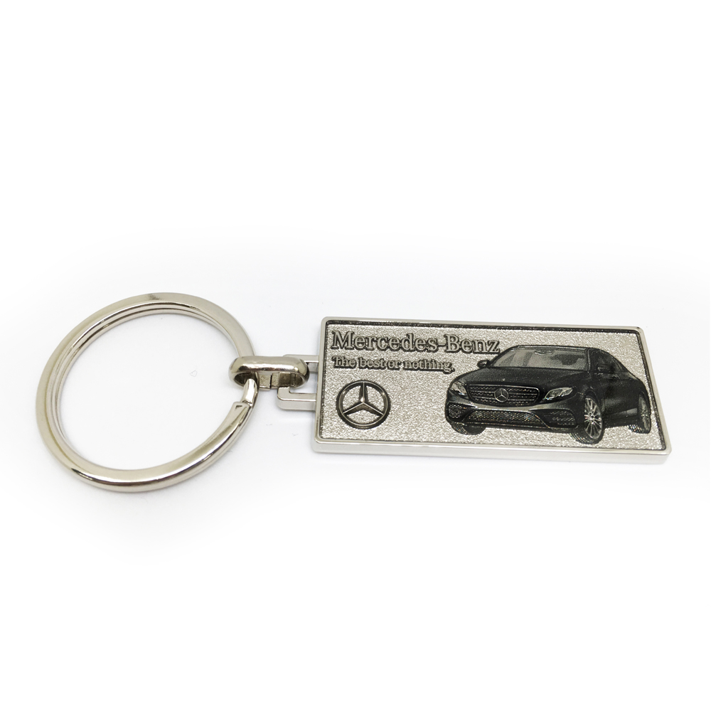 Black car keychain with grained background