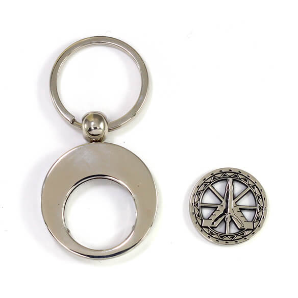 Coin key chain with cut out token